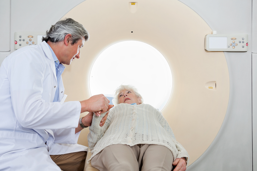 Woman preparing for a CT scan