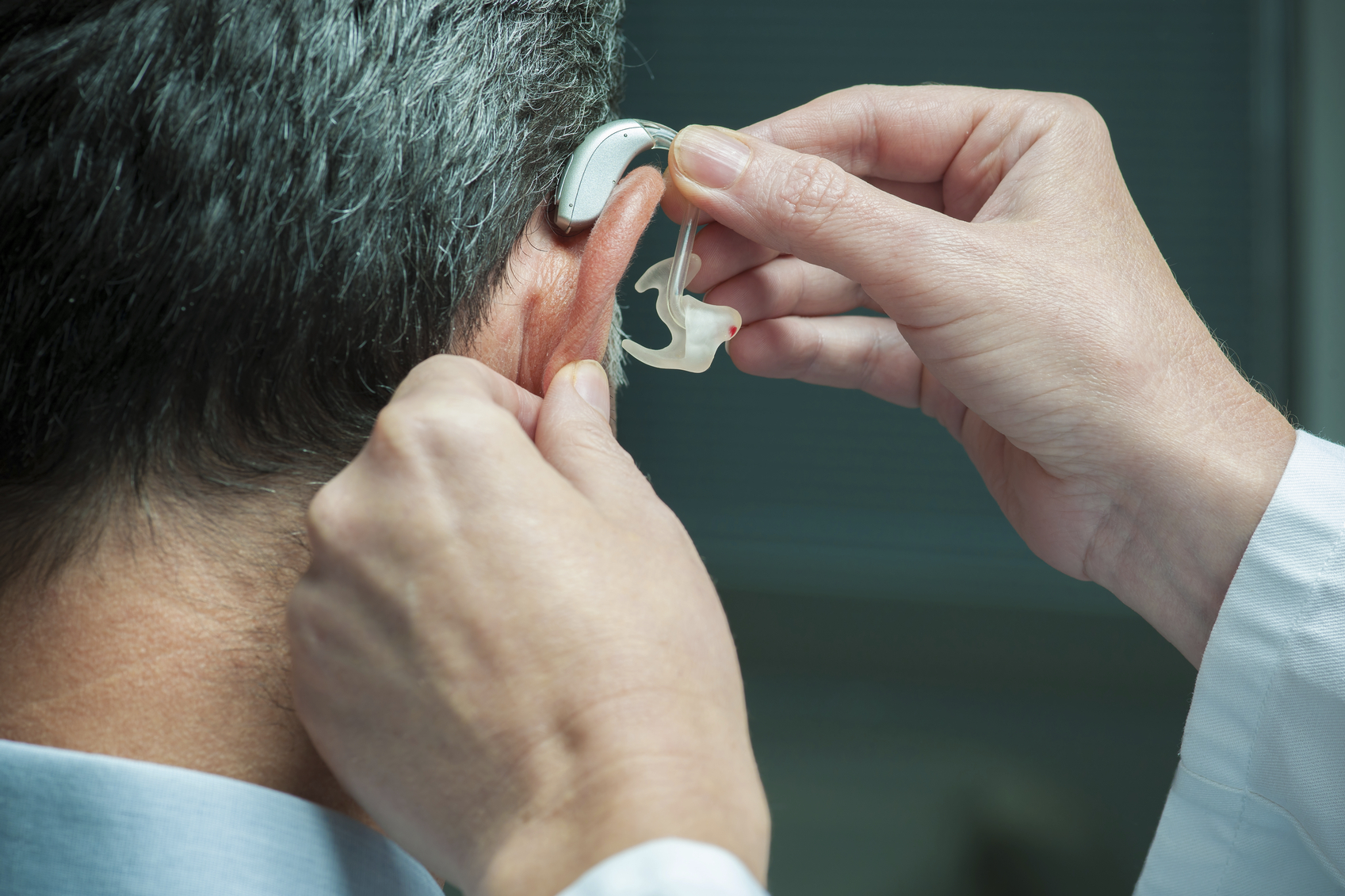 """Why men tend to resist hearing aids. """""""
