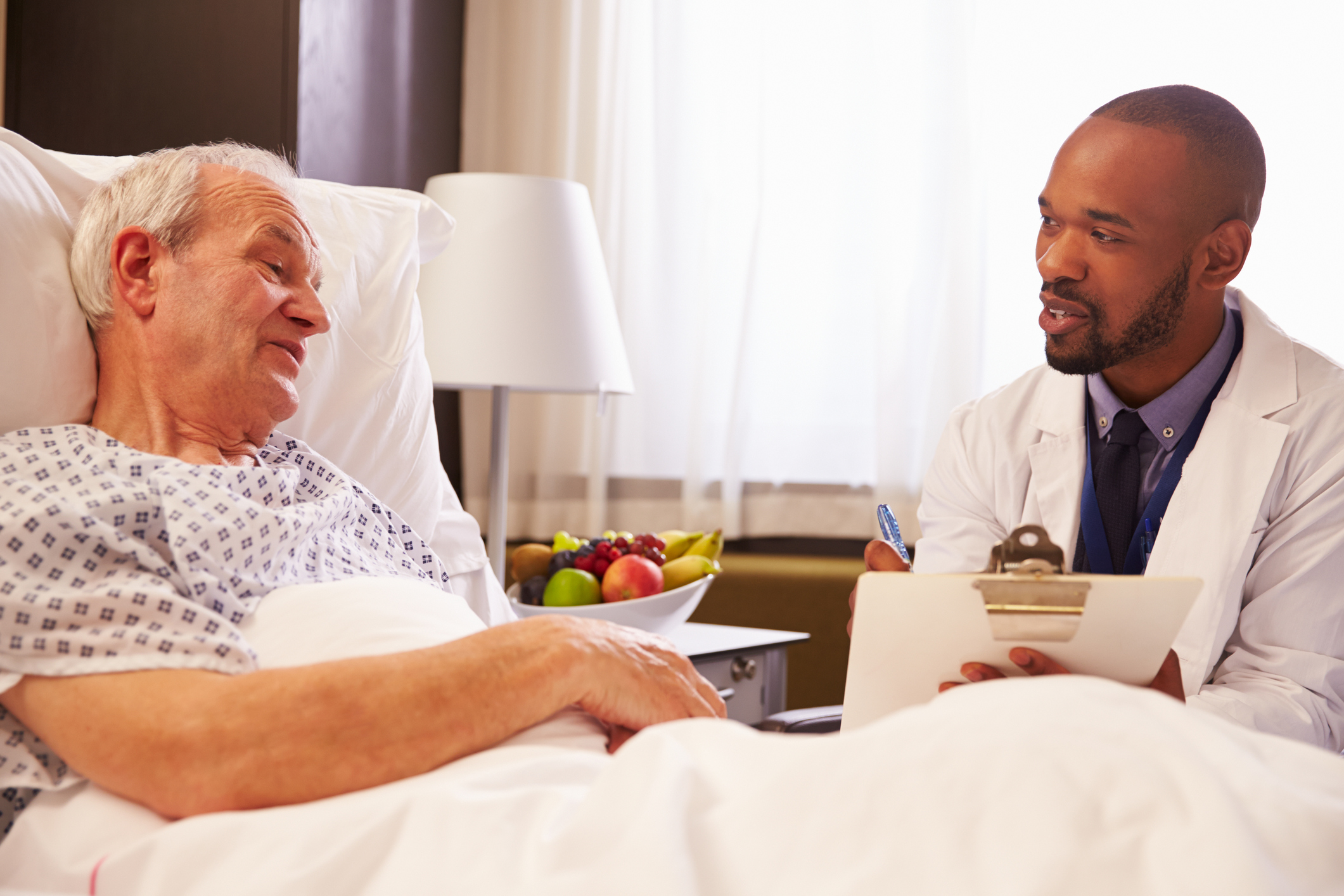 Doctor talking to patient during hospital stay