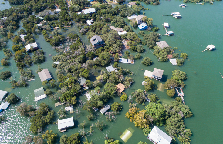 Aerial view of flooded neighborhood after disaster