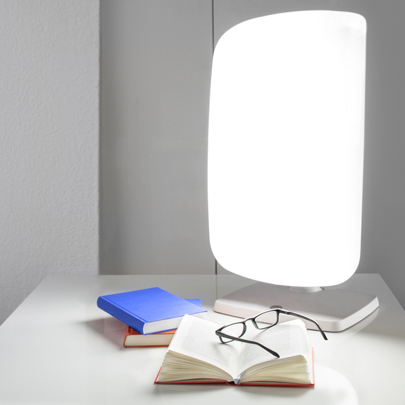 Light therapy lamp, books, and eyeglasses