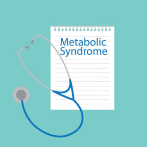Metabolic syndrome written on a notebook page with a stethoscope on top