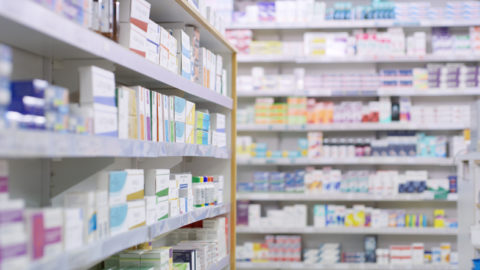 Drug store shelves stocked with many medicines