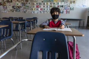 Child wearing mask in school