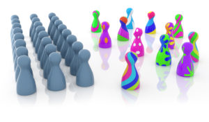 multi colored pawns opposite grey ones; concept of gender fluidity