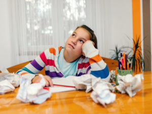 girl with executive function difficulties doing homework