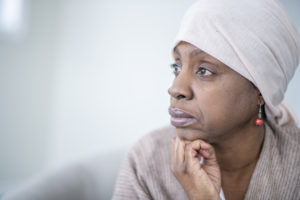 older African American woman looking thoughtful