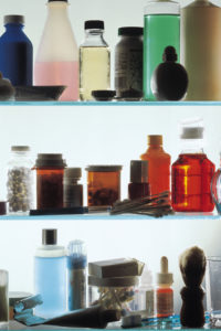Medicine bottles on shelves in medicine cabinet