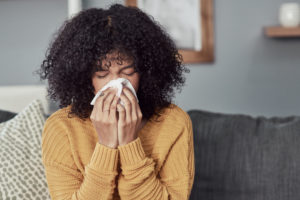 Young woman with allergies
