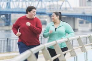 overweight couple exercising